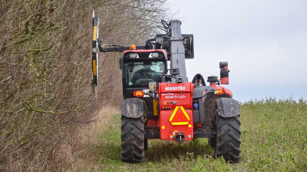 Farm hedge cutting with telehandler