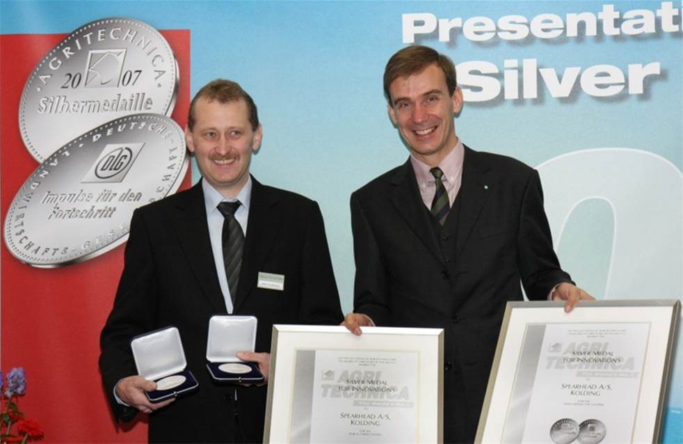 John Christensen is handed a silver medal in innovation at Agritechnica